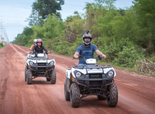 Riding Quad Atvs On Gold Zipline Tour In Angkor Park